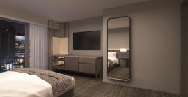 A spacious accessible hotel room equipped with a full-sized mirror