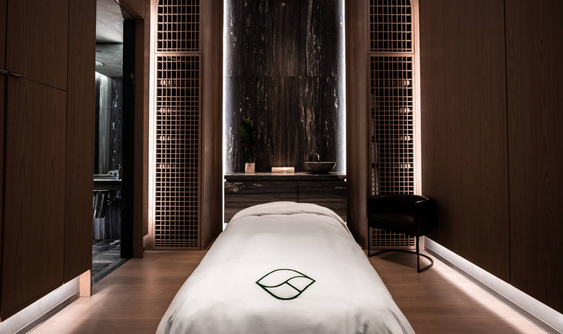 Interior view of a massage table in a private room at Fairmont Century Plaza's luxury spa.