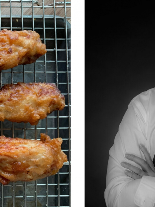 Chef Atticus Garant's golden-brown Touchdown Wings on a wire plate.