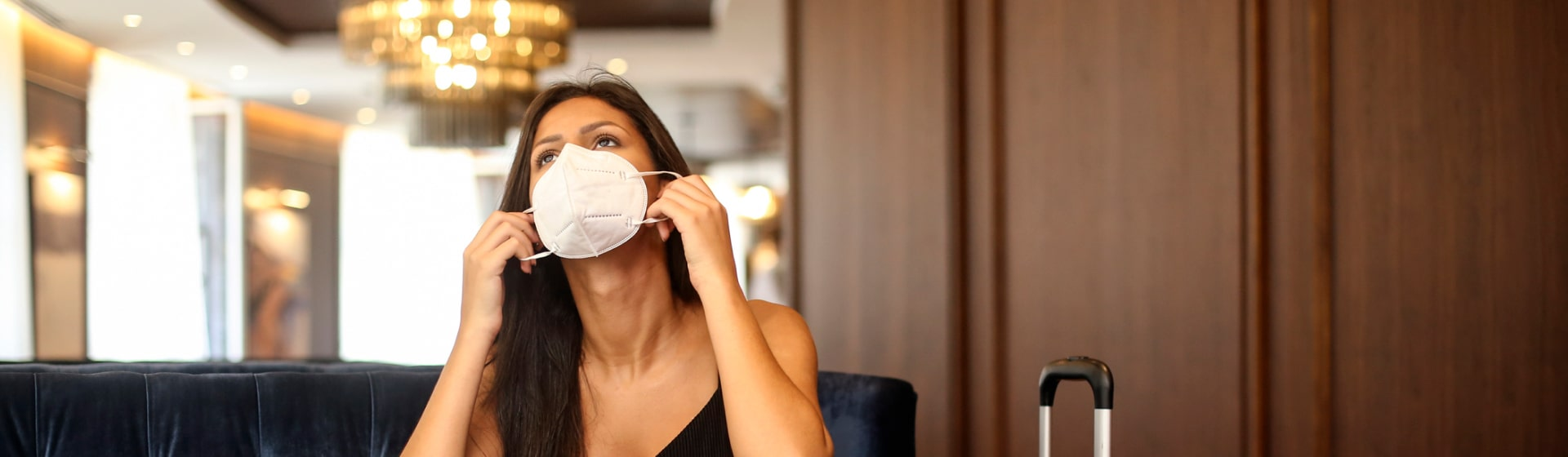 A woman dons a face mask