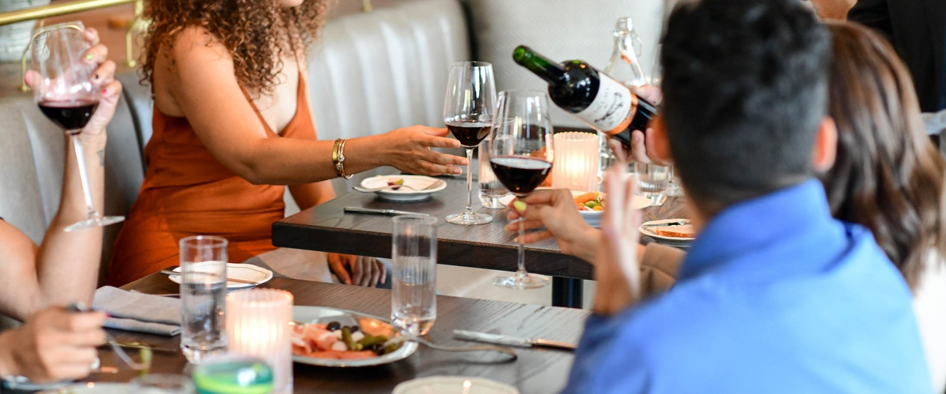 A group enjoy wine and food at the Fairmont Century Plaza.