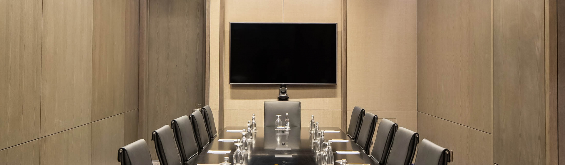 The large Century Plaza boardroom equipped with a long black table.