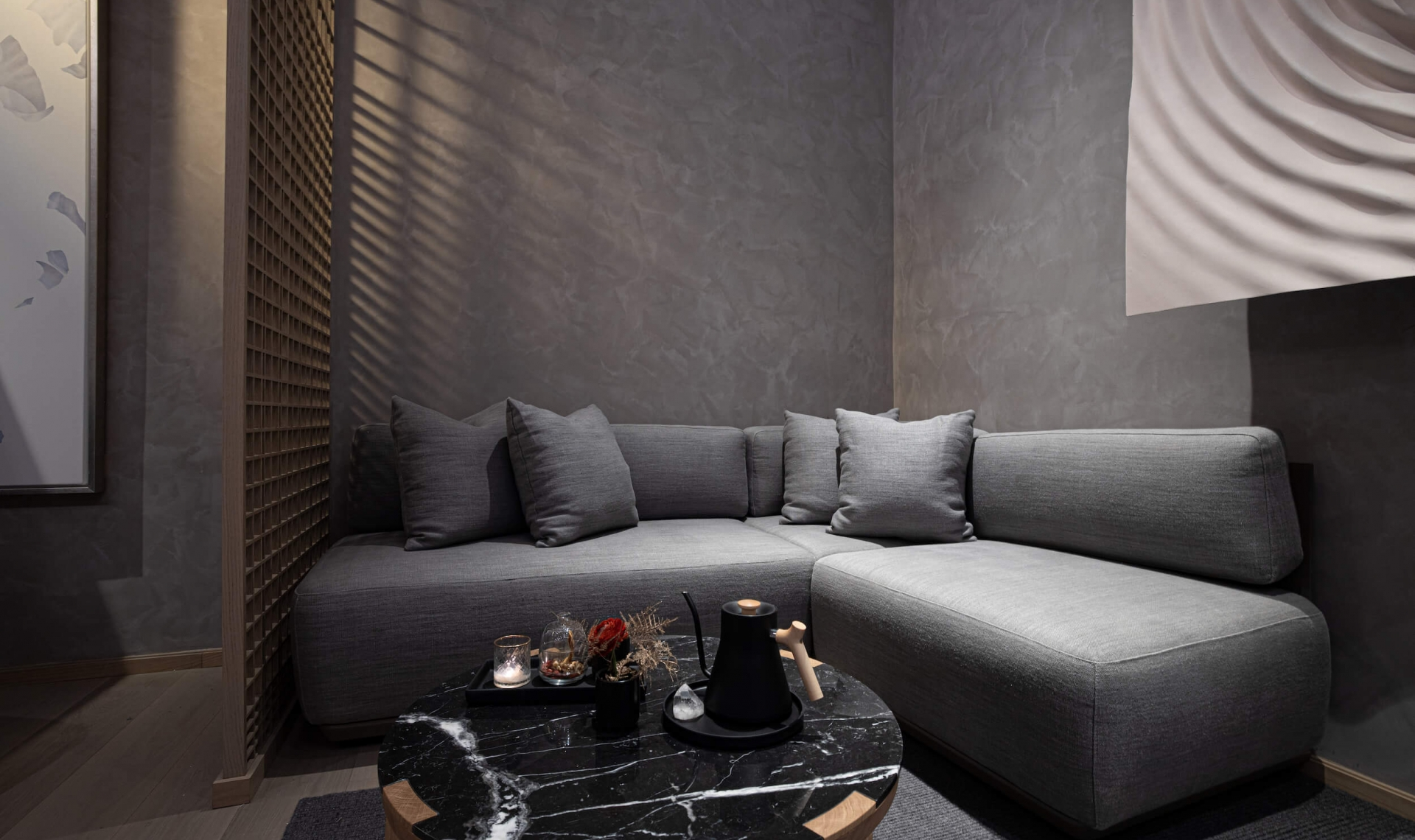 A sectional couch and a small table set with a kettle of tea in the lobby at Fairmont Century Plaza's spa.