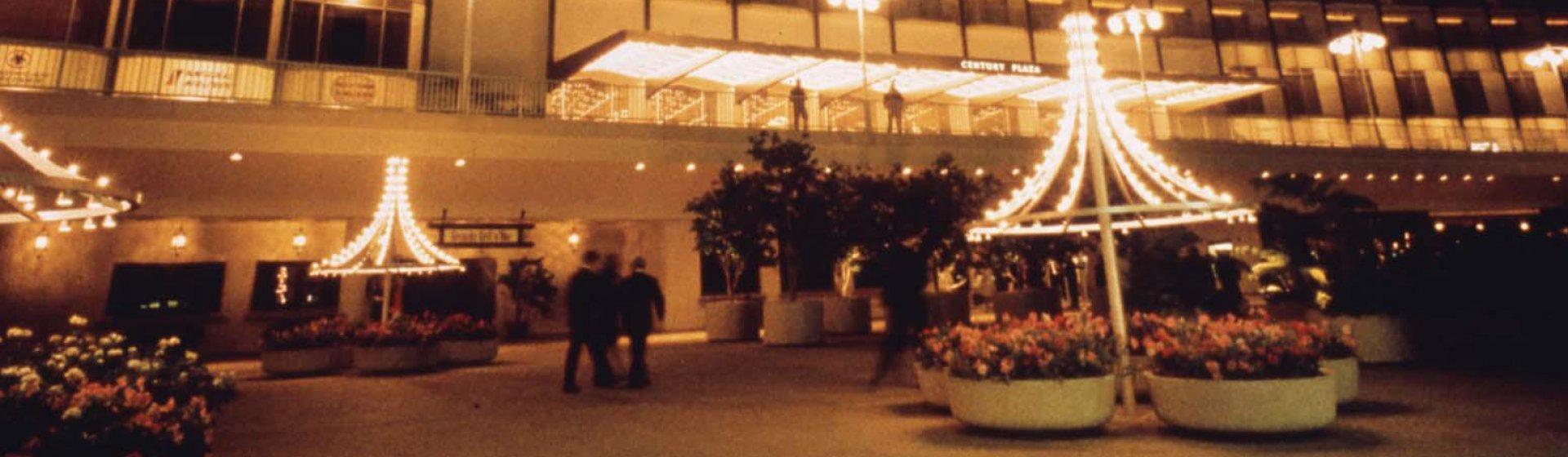 The Fairmont Century Plaza exterior at night.