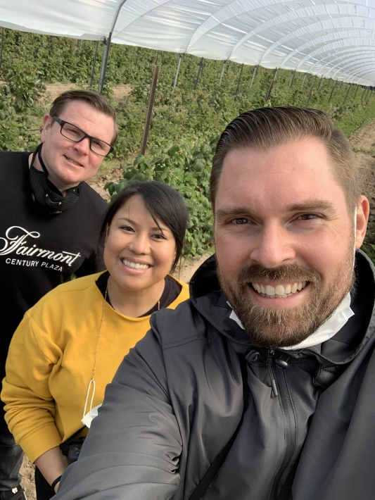 The Century Plaza culinary team take a selfie at a vegetable farm